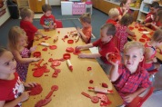 Sharing red play doh